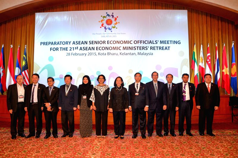 Delegates pose for a photo during the Preparatory ASEAN Senior Economic Officials' Meeting for the 21st ASEAN Economic Ministers' Retreat in Kota Bharu, ...