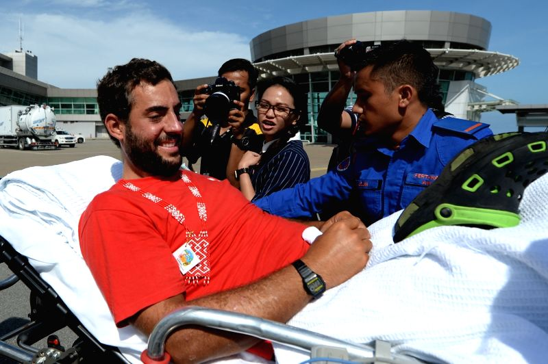 KOTA KINABALU, May 13, 2016 - A Spanish tourist who went missing at sea in Malaysia's eastern Sabah state is carried on a strecher upon his arrival at Kota Kinabalu, capital of Sabah state, on May ...