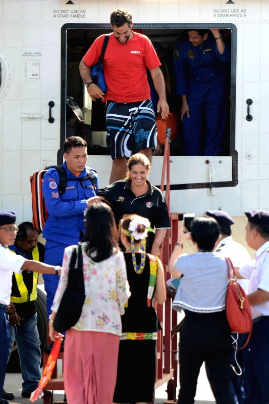 KOTA KINABALU, May 13, 2016 - Two Spanish tourists who went missing at sea in Malaysia's eastern Sabah state walk out of the plane upon their arrival at Kota Kinabalu, capital of Sabah state, on May ...