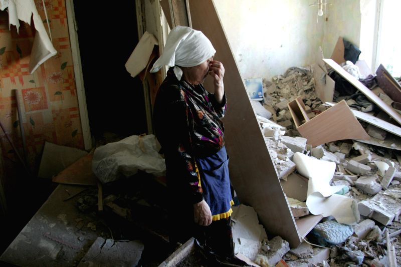 A citizen of Kramatorsk gestures in an apartment which was destroyed by artillery strike in Kramatorsk, Ukraine, on July 3, 2014. Ukrainian troops used aircrafts .