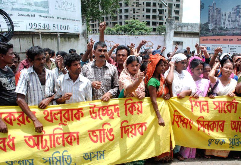 Krishak Mukti Sangram Samiti (KMSS) activists during a demonstration in Guwahati on July 18, 2014.