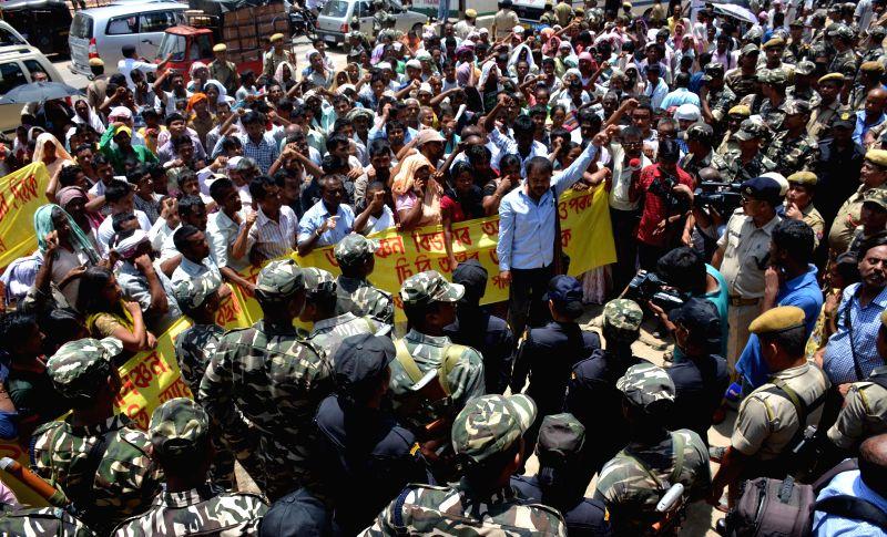 Krishak Mukti Sangram Samiti (KMSS) activists led by their leader Akhil Gogoi demonstrate to press for their demands in Guwahati on Aug 8, 2014.