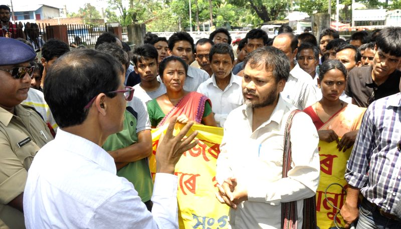 Krishak Mukti Sangram Samiti (KMSS) leader Akhil Gogoi  being whisked away by police while they were going to stage hunger strike at The Office of the  Director, Medical Education, ...