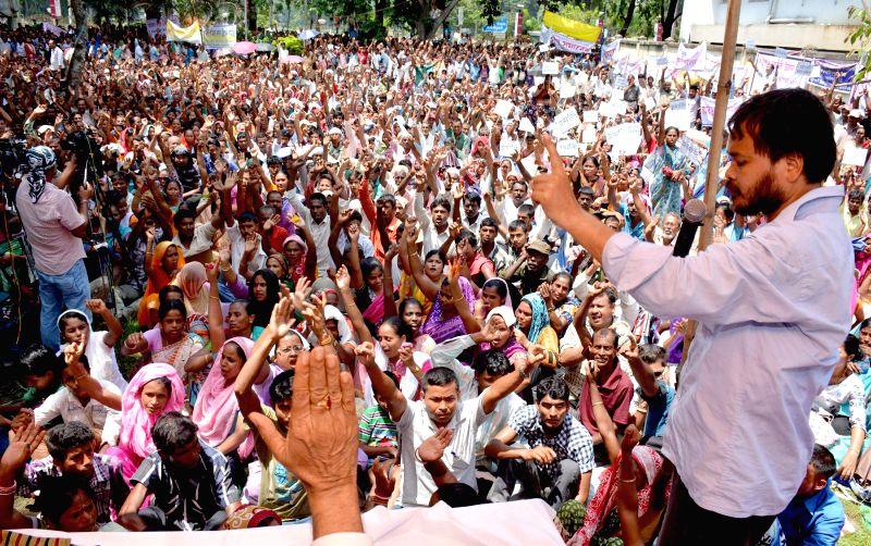 Krishak Mukti Sangram Samiti (KMSS) president Akhil Gogoi addresses a public meeting in Guwahati on July 6, 2014.