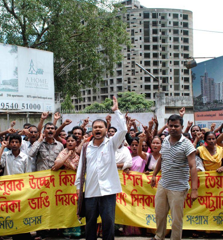 Krishak Mukti Sangram Samiti (KMSS) president Akhil Gogoi and other activists during a demonstration in Guwahati on July 18, 2014.