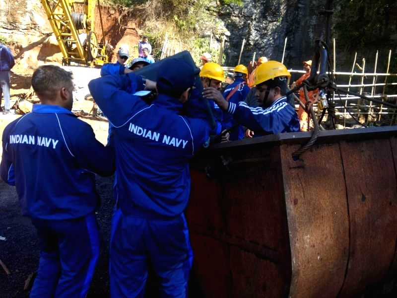 Ksan: Navy divers prepare to enter into the illegal coal pit filled with water where 15 miners are trapped inside for 18 days now, in Ksan of Meghalaya's East Jaintia Hills district on Dec 31, 2018. The Indian Navy and National Disaster Response Forc(Image Source: IANS News)