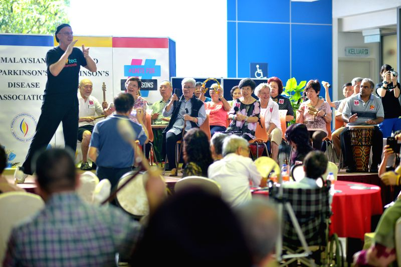 KUALA LUMPUR, April 22, 2017 - People suffered with Parkinson's disease play percussion music during an event to promote awareness of Parkinson's disease in Kuala Lumpur, Malaysia, on April 22, 2017.