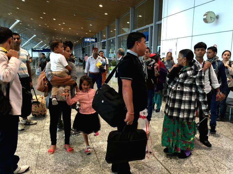Nepalese passengers wait for flights back to Nepal at Kuala Lumpur International Airport in Kuala Lumpur, capital of Malaysia, on April 26, 2015. A total of ... - Kamal Singh Bam