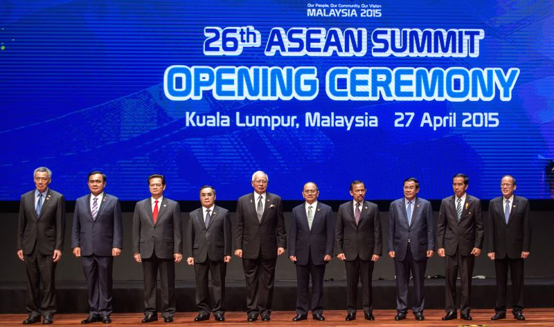 Leaders pose for a group photo at the opening ceremony of the 26th Association of Southeast Asian Nations (ASEAN) summit in Kuala Lumpur, Malaysia, April 27, ... - Najib Razak