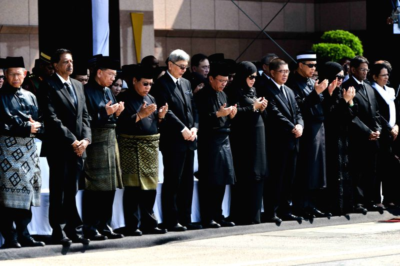 Malaysian officials pray for victims of the crashed MH17 flight during a repatriation ceremony at Kuala Lumpur International Airport in Sepang, Malaysia, ...