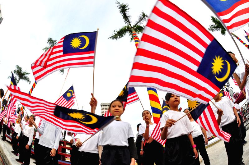 People attend a rehearsal of the 57th Malaysian National Day celebration activity in Kuala Lumpur, Aug. 29, 2014. Malaysia will celebrate its 57th National Day