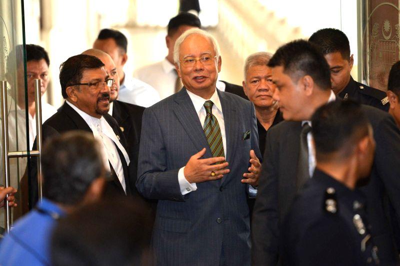 KUALA LUMPUR, Aug. 8, 2018 - Former Malaysian Prime Minister Najib Razak (C) appears at the Kuala Lumpur Courts complex in Kuala Lumpur in Malaysia, Aug. 8, 2018. Former Malaysian Prime Minister ... - Najib Razak