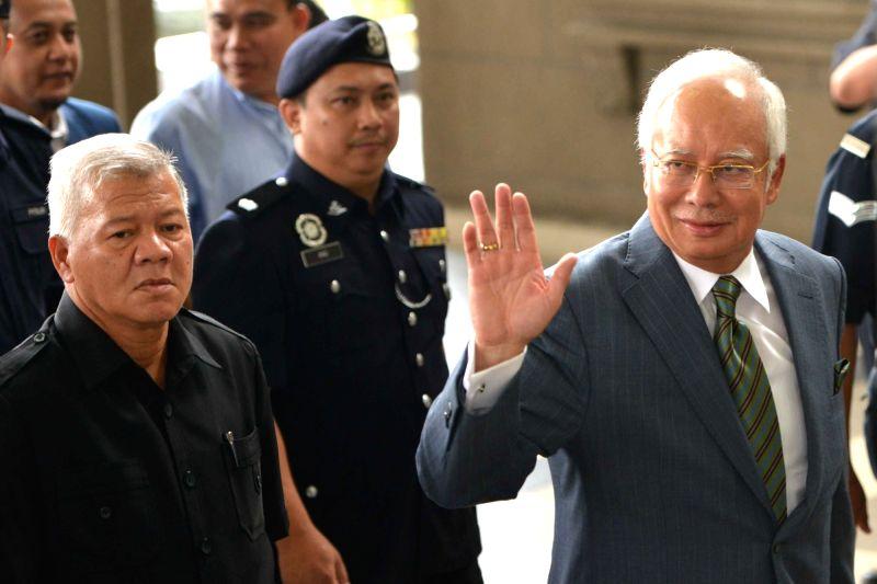KUALA LUMPUR, Aug. 8, 2018 - Former Malaysian Prime Minister Najib Razak (R) appears at the Kuala Lumpur Courts complex in Kuala Lumpur in Malaysia, Aug. 8, 2018. Former Malaysian Prime Minister ... - Najib Razak