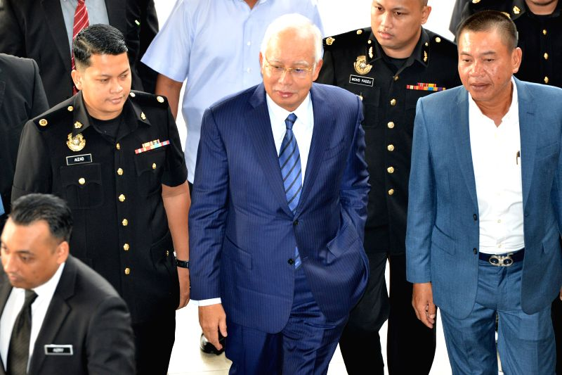 KUALA LUMPUR, Dec. 12, 2018 (Xinhua) -- Former Malaysian Prime Minister Najib Razak (C) arrives at a court in Kuala Lumpur, Malaysia, Dec. 12, 2018. Najib Razak was charged on Wednesday for tampering an audit report related to state investment fund 1