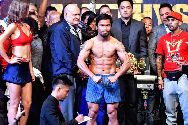 KUALA LUMPUR, July 14, 2018 - Boxing legend Manny Pacquiao (C) weighs in Kuala Lumpur, Malaysia, July 14, 2018. The highly anticipated fight between Manny Pacquiao and Lucas Matthysse, the ...