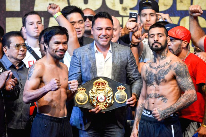 KUALA LUMPUR, July 14, 2018 - Lucas Matthysse (R), the Argentinean World Boxing Association (WBA) welterweight champion, and Manny Pacquiao (L) of Philippines weighs in Kuala Lumpur, Malaysia, July ...