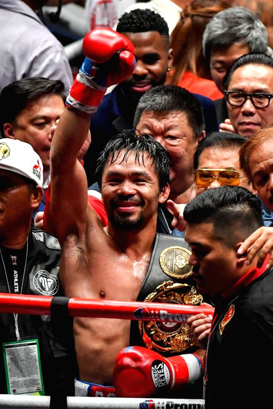 KUALA LUMPUR, July 15, 2018 - Manny Pacquiao of the Philippines celebrates after defeated Lucas Matthysse of Argentina for world welterweight champion title in Kuala Lumpur, Malaysia, July 15, 2018. ...