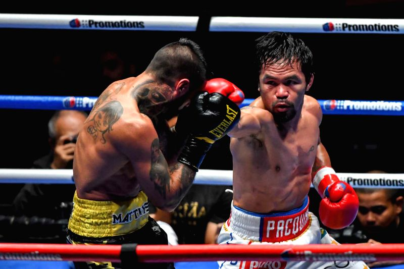 KUALA LUMPUR, July 15, 2018 - Manny Pacquiao (R) of the Philippines competes against Lucas Matthysse of Argentina for world welterweight champion title in Kuala Lumpur, Malaysia, July 15, 2018. Manny ...