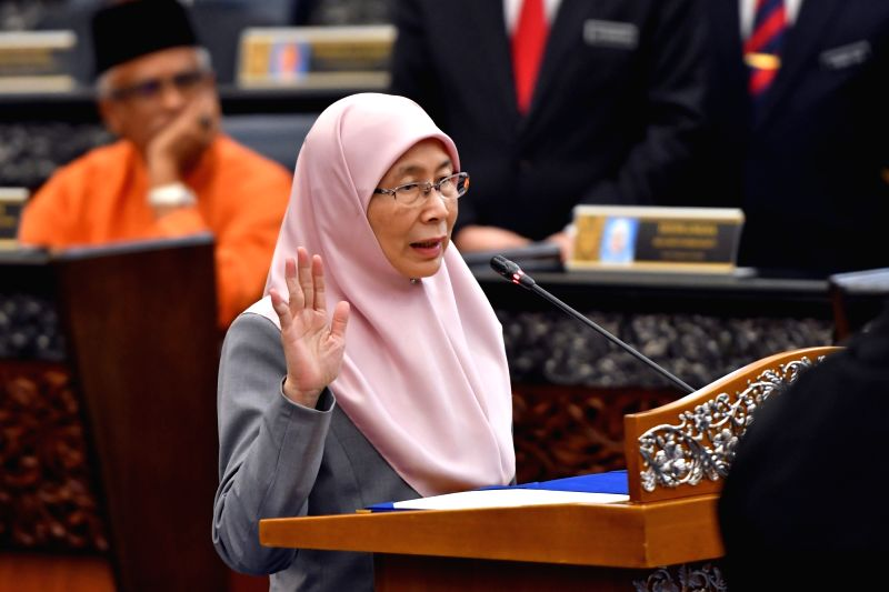 KUALA LUMPUR, July 16, 2018 - Malaysian Deputy Prime Minister Wan Azizah Wan Ismail swears in as parliament member in Kuala Lumpur, on July 16, 2018. Malaysia's Members of Parliament were sworn in on ... - Wan Azizah Wan Ismail