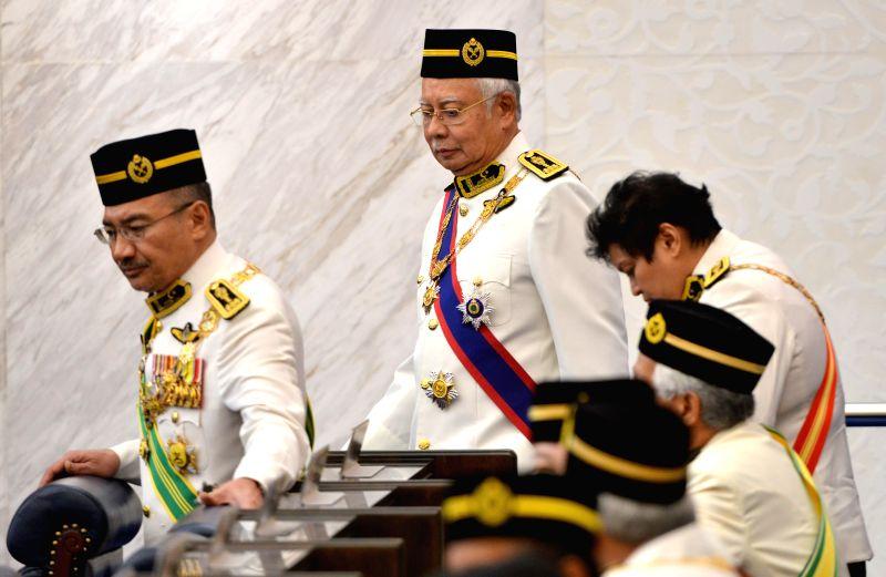 KUALA LUMPUR, July 17, 2018 - Former Malaysian Prime Minister Najib Razak (C) arrives at the parliament in Kuala Lumpur, Malaysia, on July 17, 2018. Malaysia's new parliament session officially ... - Najib Razak
