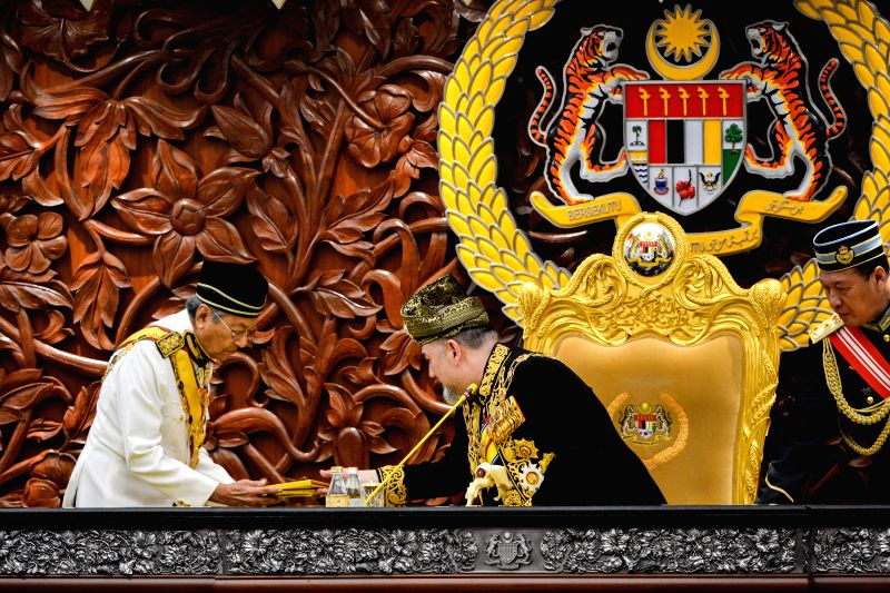 KUALA LUMPUR, July 17, 2018 - Malaysian King Sultan Muhammad V (C) receives the opening speech from Prime Minister Mahathir Mohamad (L) at the parliament in Kuala Lumpur, Malaysia, on July 17, 2018. ... - Mahathir Mohamad