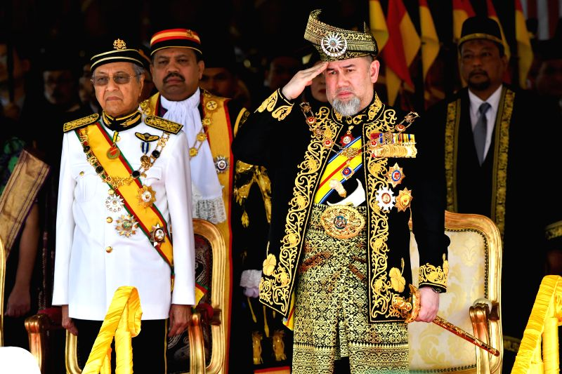 KUALA LUMPUR, July 17, 2018 - Malaysian King Sultan Muhammad V (R, front) and Prime Minister Mahathir Mohamad (L, front) review the royal guard of honour during the opening ceremony of the parliament ... - Mahathir Mohamad
