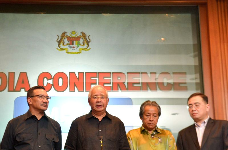 Malaysian Prime Minister Najib Razak (2nd L) attends a press conference at a hotel at the Kuala Lumpur International Airport, in Kuala Lumpur, Malaysia, July ..