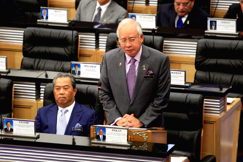 Malaysian Prime Minister Najib Razak attends a specially convened session of Parliament in Kuala Lumpur July 23, 2014. Najib Razak on Wednesday condemned the ..