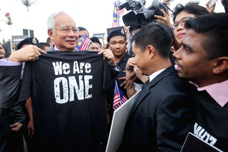 Malaysian Prime Minister Najib Razak meets with protestors outside the Parliament in Kuala Lumpur, Malaysia, July 23, 2014. Najib Razak on Wednesday condemned .