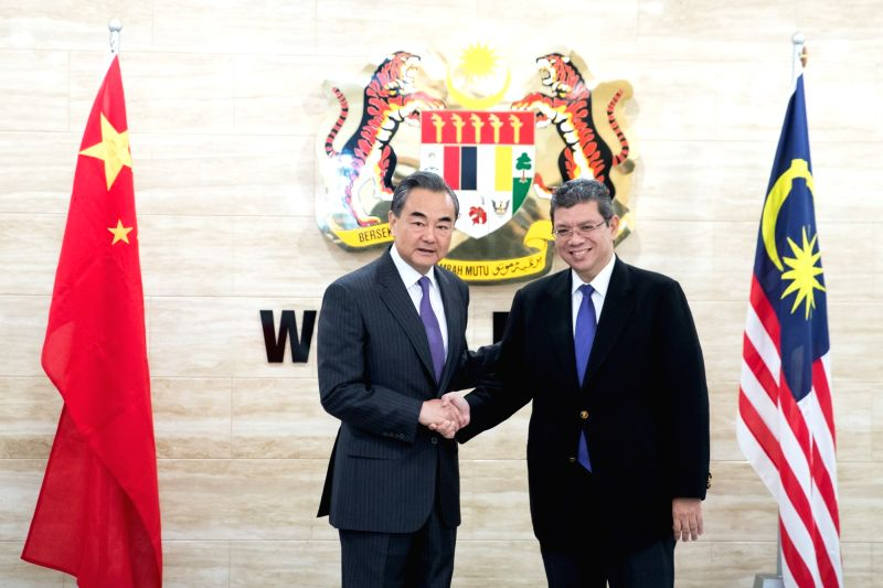 KUALA LUMPUR, July 31, 2018 - Chinese State Councilor and Foreign Minister Wang Yi (L) shakes hands with Malaysian Foreign Minister Saifuddin Abdullah prior to their talks in Malaysia, July 31, 2018. ... - Wang Y