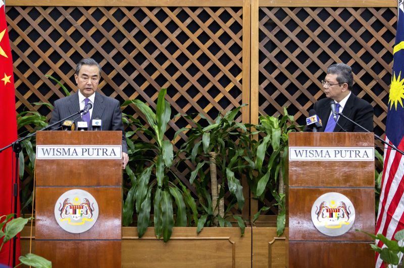KUALA LUMPUR, July 31, 2018 - Visiting Chinese State Councilor and Foreign Minister Wang Yi (L) and Malaysian Foreign Minister Saifuddin Abdullah attend a joint media briefing after their meeting in ... - Wang Y