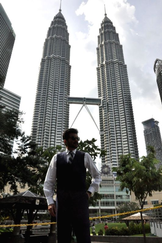 Kuala Lumpur (Malaysia): Actor Anil Kapoor poses for a photo with Kuala Lumpur's iconic Petronas Towers.