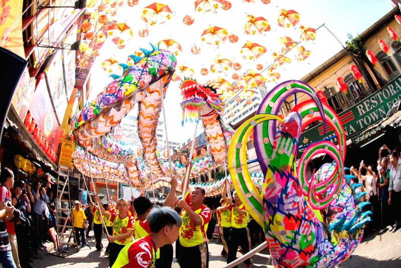 People watch a dragon dance to celebrate the Lantern Festival in Kuala Lumpur, Malaysia, March 5, 2015. The festival, which falls on March 5 this year, is ...
