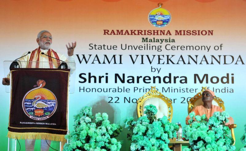 Kuala Lumpur: Prime Minister Narendra Modi addresses at the statue unveiling ceremony of Swami Vivekananda in Ram Krishna Mission, Kuala Lumpur, Malaysia on Nov 22, 2015. - Narendra Modi