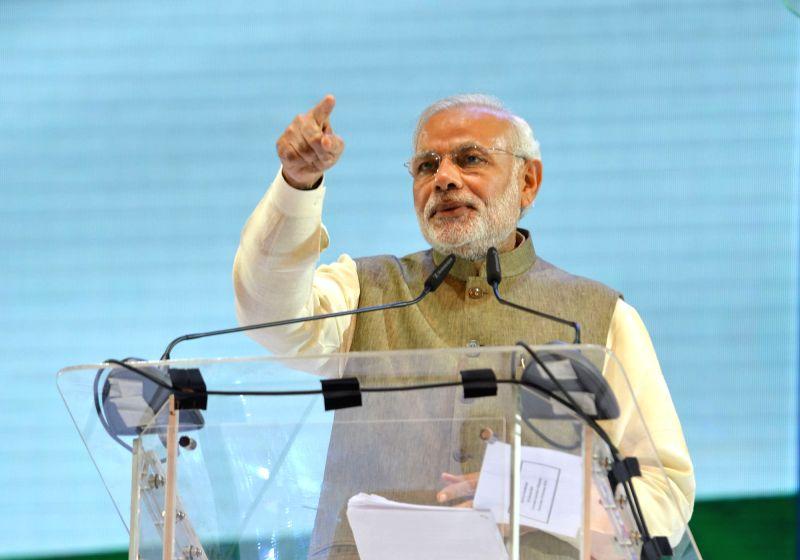 Kuala Lumpur: Prime Minister Narendra Modi addresses at a Community Programme, in Kuala Lumpur, Malaysia on Nov 22, 2015. - Narendra Modi