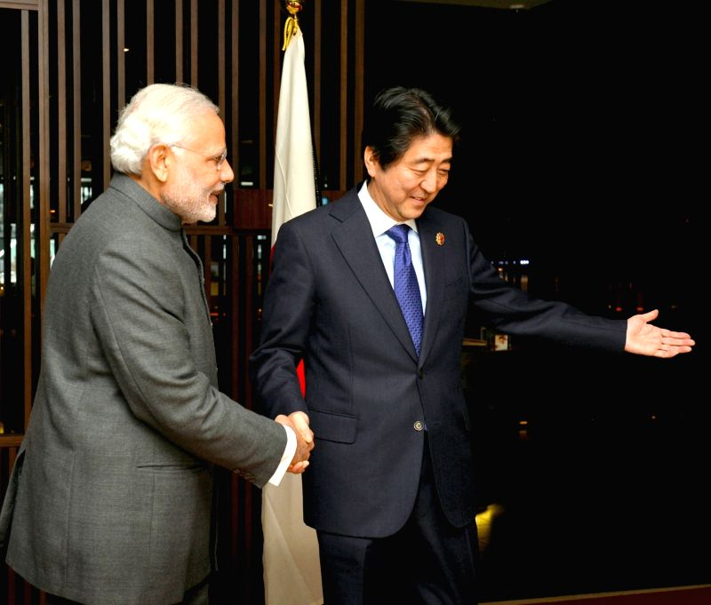 Kuala Lumpur: Prime Minister of Japan Shinzo Abe hosts the Prime Minister Narendra Modi for the second bilateral meeting, at Kuala Lumpur, in Malaysia on November 21, 2015. - Narendra Modi
