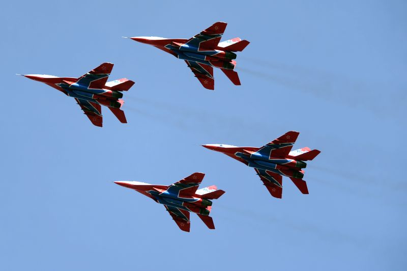Jet fighters Mikoyan MiG-29 of the Swifts, Russian aerobatic team, fly during the parade rehearsal dedicated to the 70th anniversary of the victory in World War II, ...
