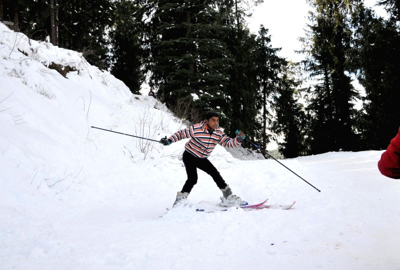A boy enjoys skiing in snow covered Kufri, near Shimla.