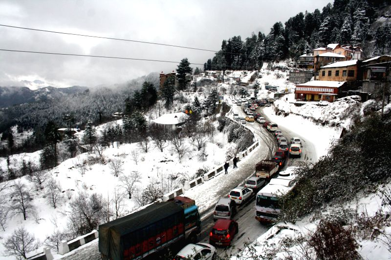 Heavy traffic jam after season`s first snowfall at Kufri, some 17 Kms Shimla on Dec. 13, 2014.