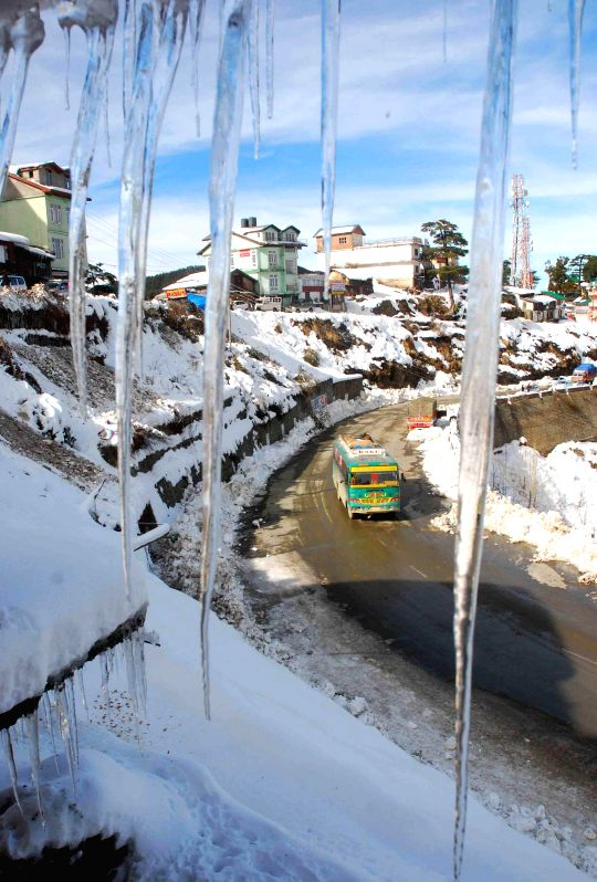 Icicles hang from the roof of a building at Kufri, Himachal Pradesh on Dec 18, 2014.