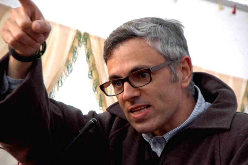 Jammu and Kashmir Chief Minister Omar Abdullah addresses a rally ahead of assembly polls in Kulgam district of the state on Nov 25, 2014. - Omar Abdullah