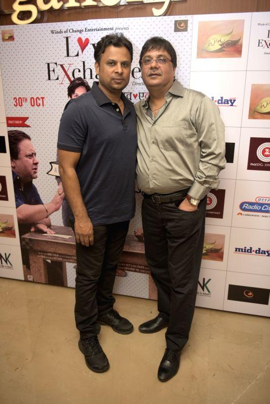 Kumaar (Lyricist) with Jaidev Kumar (Music Director) during the premiere of film Love Exchange in Mumbai on Oct 28, 2015. - Jaidev Kumar