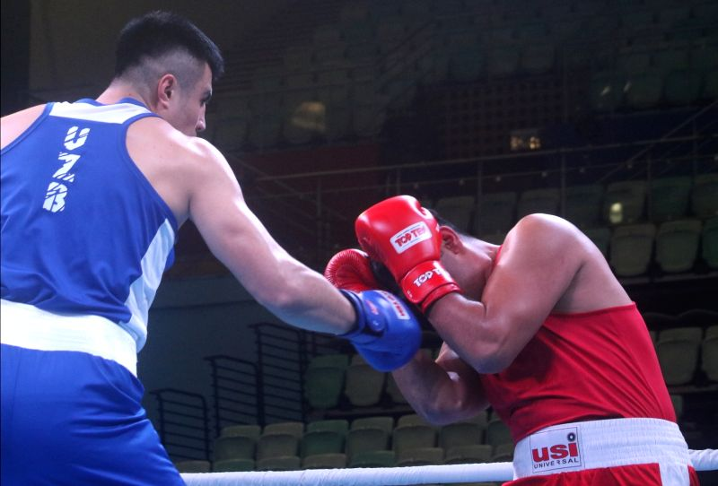 Kumar Praveen of India (Red) in acting against Bakhodir Jalolov (Blue) of Uzbekistan during the 1st India Open international boxing tournament in New Delhi, on Jan 28, 2018.