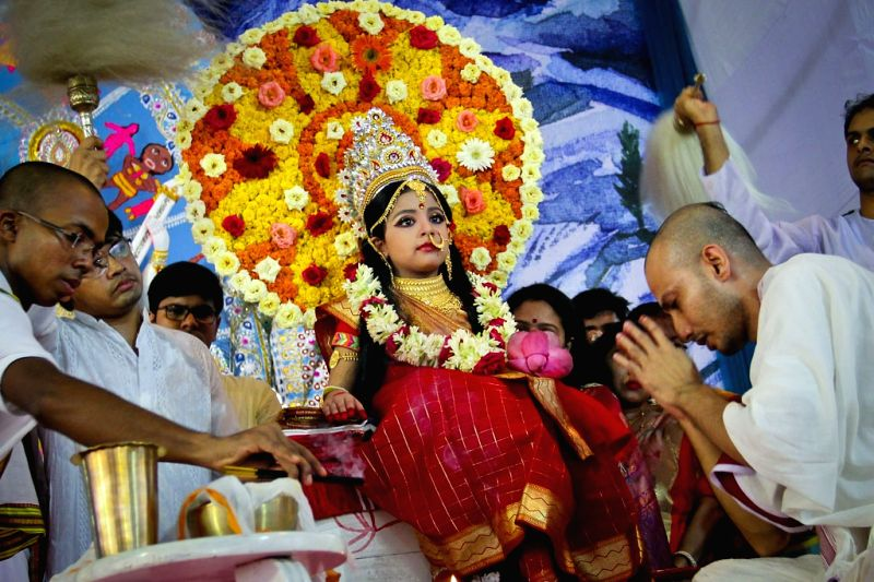 Kumari Puja/Kanya Puja being held on the Mahashtami of Durga Puja by worshiping living icon of a child Durga.