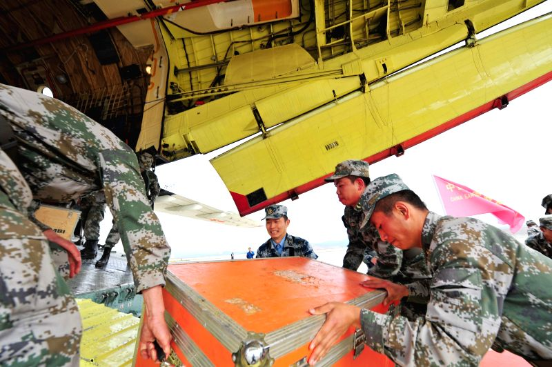 Officers and soldiers load rescue materials on an  IL-76 aircraft at an airport before departing for earthquake-stricken Nepal in Kunming, capital of southwest ...