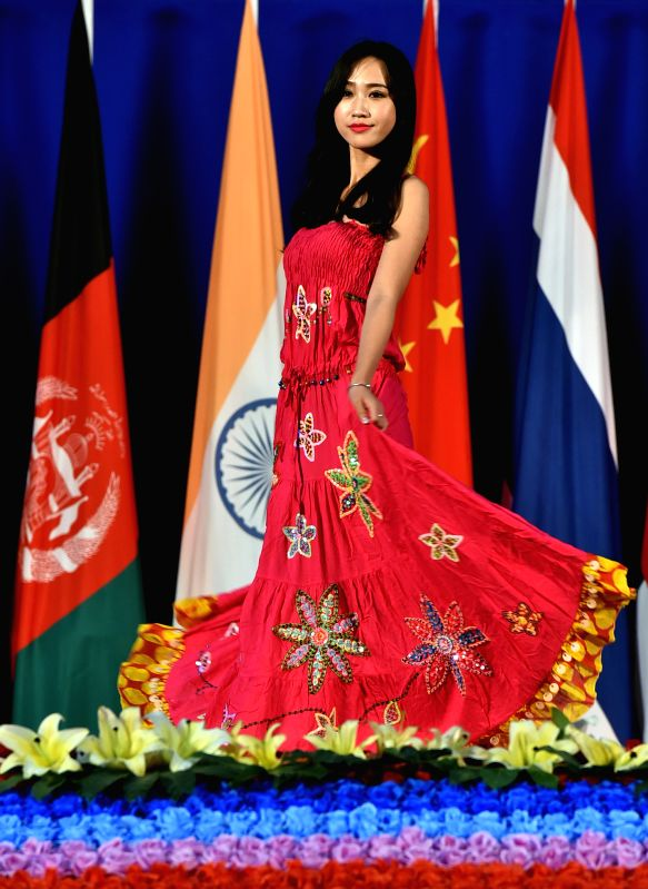 A model presents a creation at a fashion show during third China-South Asia Expo in Kunming, capital of southwest China's Yunnan Province, June 15, 2015. The third ...