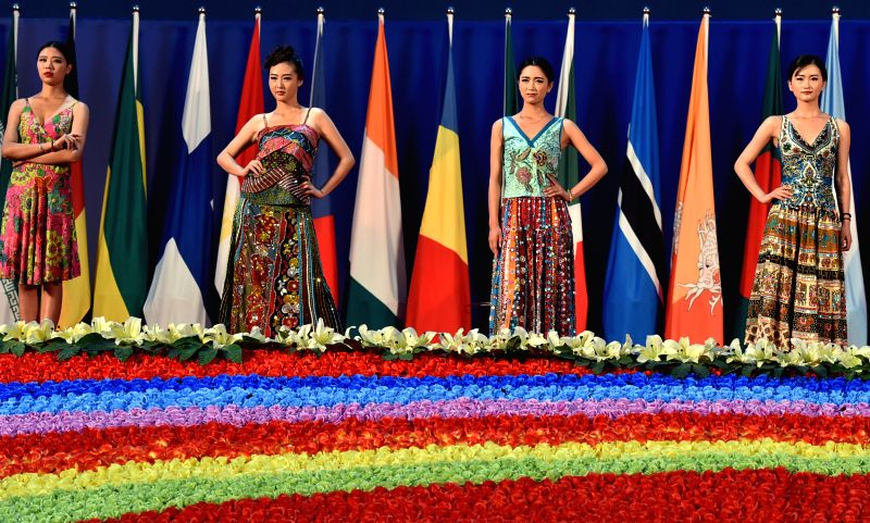 Models present creations at a fashion show during third China-South Asia Expo in Kunming, capital of southwest China's Yunnan Province, June 15, 2015. The third ...