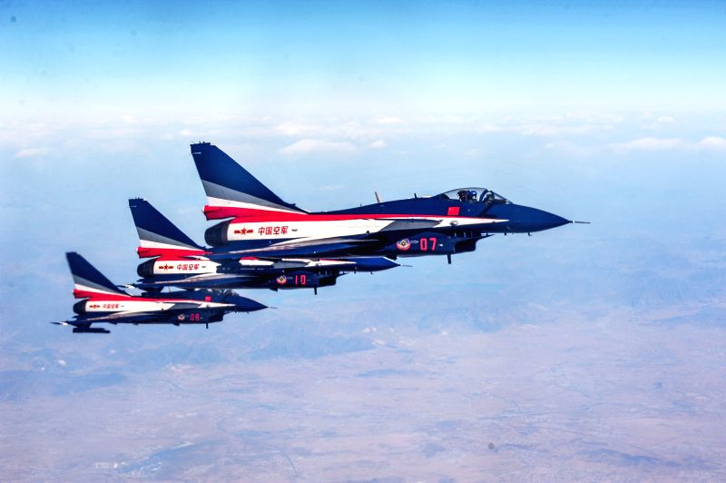 J-10 jet fighters of the Bayi Aerobatic Team of the Air Force of the Chinese People's Liberation Army exercise a flight training, March 3, 2015. Pilots Yu Xu, Tao ...