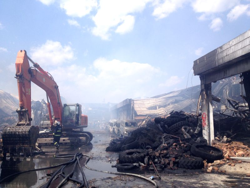 Photo taken with a cellphone on March 4, 2015 shows the site of fire at the Dongmeng Lianfeng Agricultral Trade Center in the Guandu District of Kunming, capital of ...