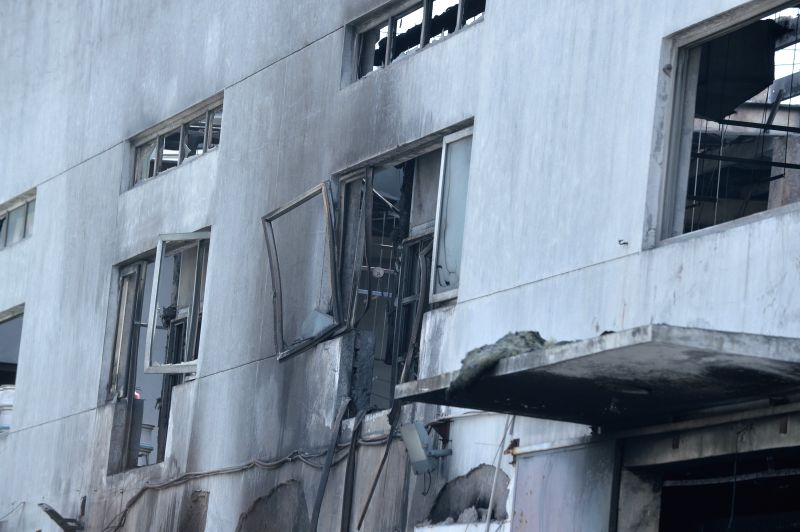 Broken windows are seen at the factory blast site in Kunshan, east China's Jiangsu Province, Aug. 2, 2014. A powerful factory blast has killed 65 people and injured .
